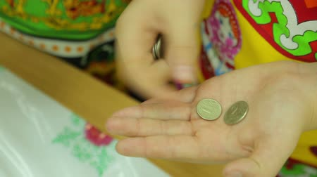 благотворительность : Charity fair, the woman counting coins in the gymnasium