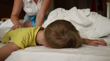 wakeup : Little boy trying to wake up, and he does not want to wake up