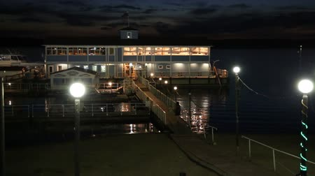 boathouse : Night view of the river Volga, ship, pier and boat station Stock Footage