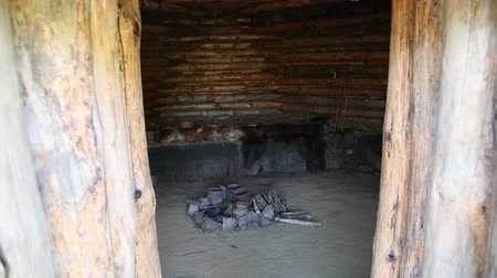 kamień : Ancient dwelling of the Stone or Bronze Age, the entrance, a hearth, pottery, animal skins