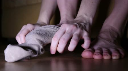 delikleri : A woman wears holey socks, the symptom of poverty of a person Stok Video