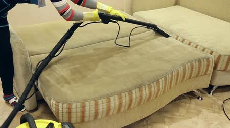 cleaning equipment : Service cleaning dirty sofa and chairs with special tool, the detergent is applied, operation of the wet and dry vacuum cleaner Stock Footage