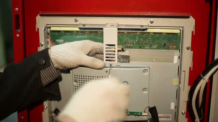 engineering : The scientist twists the screws  using screwdriver in the switchboard with electrical boards