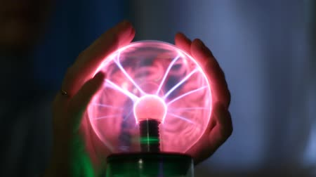 явление : People touching hands of a lightning magic ball
