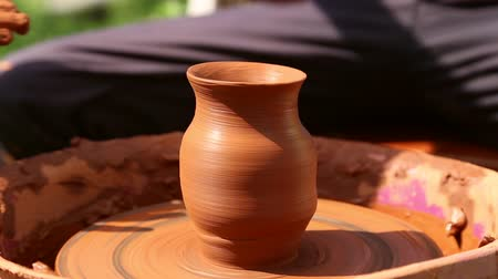 potter wheel : Potter makes pottery clay on a Potters wheel, wheel stops Stock Footage