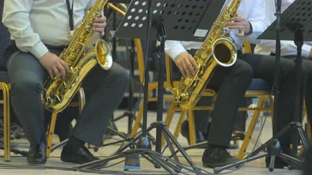 jazzman : Musicians playing saxophones at the stage, 4k close-up. Stock Footage
