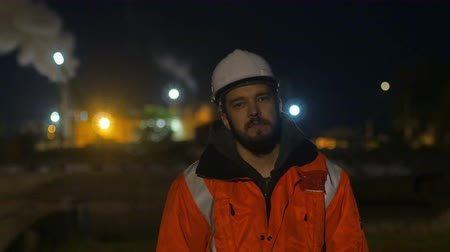 Construction worker tired and standing asleep in the twilight.overworking.4k Stock Footage