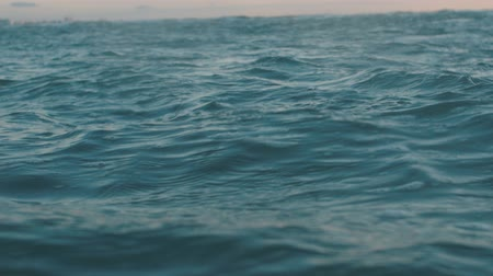 Slow motion video of sea water surface. Dackground for movie credits or intro Stock Footage