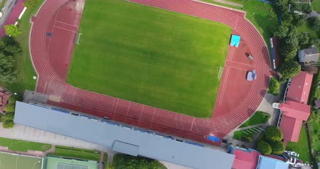 4k Drone shoot of the football field with stadium. Stock Footage