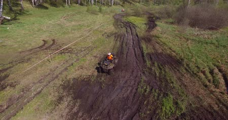 quad bike : NOVOSIBIRSK, RUSSIA - MAY 15, 2015: Mud racing with ATVs Stock Footage