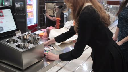 плата : Young girl pays card in the cafe