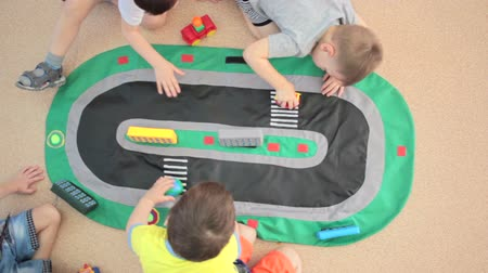 fantazja : Children playing with toys. Young 3-5 year old boys playing with car toys