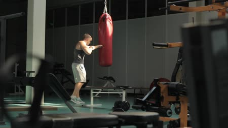 Man in gym practicing boxing