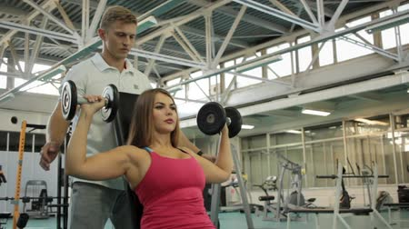 Man training young woman