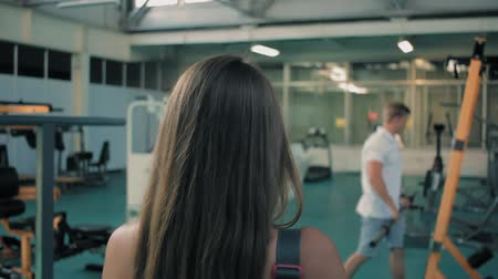 Girl in gym having personal training