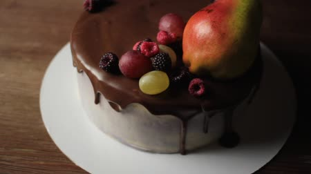 Fruits and berries on top of cake Stok Video