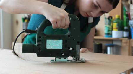 plywood : Woman working with jigsaw