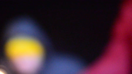 blurring : A blurred silhouette of a man in a defocused frame celebrating the holiday of new year and Christmas waving sparkling Bengal fire at night. Stock Footage