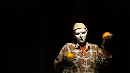 grim : Ghost mime dances with pumpkins on Halloween