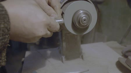 grindstone : The worker sharpens the tool. Work on a sharpening machine.