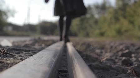 admission : girl walks on rails