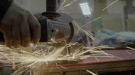 angle grinder : Angle Grinder cuts steel plate Stock Footage
