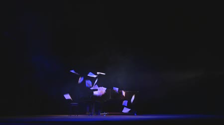 Piano music on stage and falling