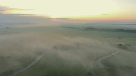 River valley with fog. Flight by dron.