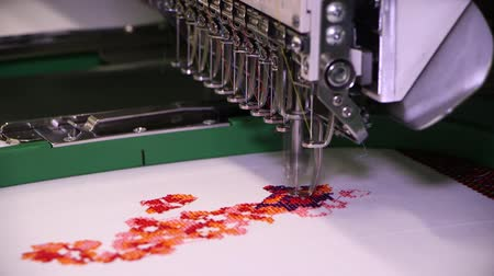 The embroidery machine is used to create patterns on textiles. Vídeos