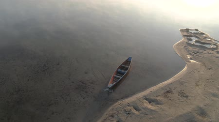 personalidade : Flight over wooden lonely boat on Lake Svityaz Ukraine.