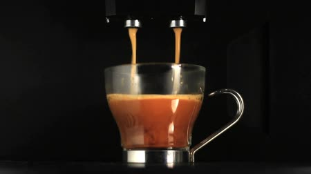 black coffee : Close up of coffe preparation with an espresso coffee machine. Find similar clips in our portfolio. Stock Footage