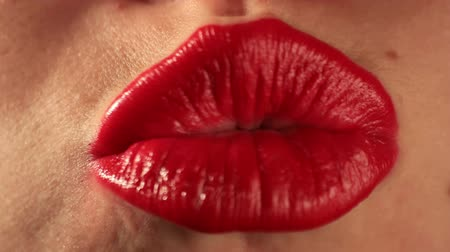 ruj : Woman mouth making kisses. Find similar clips in our portfolio. Stok Video