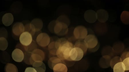 złoto : Firework out of focus - bokeh background.  Find similar clips in our portfolio.
