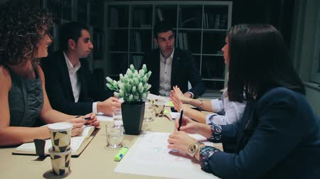 Teamwork having a meeting about business strategy sitting at table in company headquarters