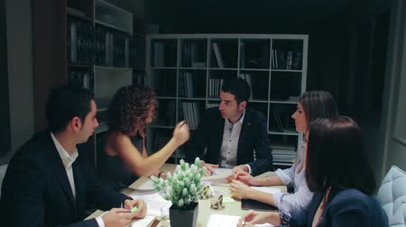 Teamwork having a hard quarrel in a business meeting sitting at table in company headquarters