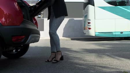 dobrado : Businesswoman picking up and saving electric scooter in the car trunk