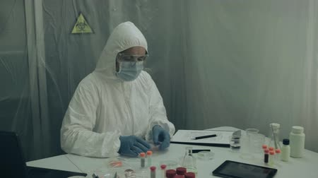 bacteriological : Scientist examining virus in petri dish in a laboratory Stock Footage