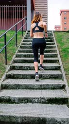 gif : Unrecognizable female athlete training climbing stairs outdoors Stock Footage