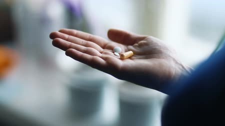Medicines in hand epic closeup woman drinking cure pills drugs at home healthcare concept, Steady cam, slow mo shot