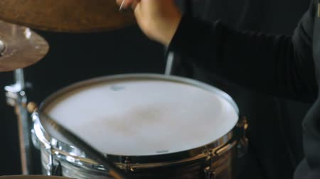 cymbals : Studio rehearsal of man playing on drums closeup Stock Footage