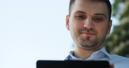 public worker : Smiling man businessman lawyer doctor manager programmer office worker using his pad on street tablet Stock Footage