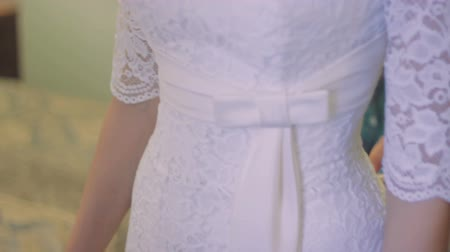 espartilho : White Wedding Dress With Lace on The Bride Stock Footage