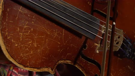 threadbare : kid playing an old shabby cello