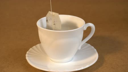teabag : brew teabag in Cup of tea Stock Footage