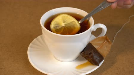 teabag : brew teabag and lemon in Cup of tea