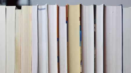 сбор : camera passes a lot of books in a row, dolly tracking