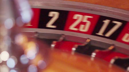 szerencsejáték : scene shows a part of a turning roulette wheel - big numbers Stock mozgókép