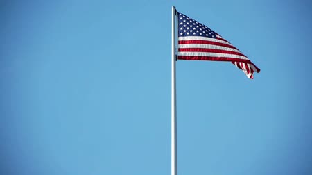 alkotmány : the star spangled banner is blowing in the wind with a bright blue sky