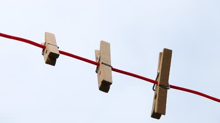 cleaning equipment : some pegs, clothespins on clotheslines waving in the wind Stock Footage