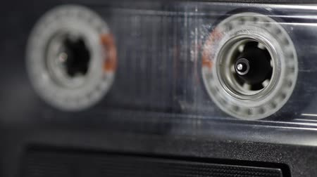 лента : scene shows some old cassette tape deck with a cassette tape running